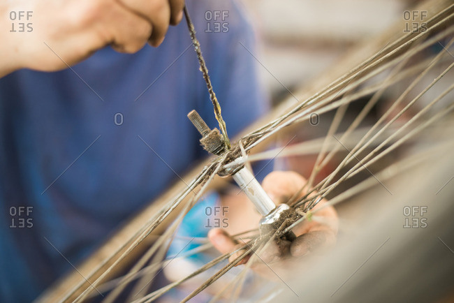 Man putting lube on the bolt of a bike tire
