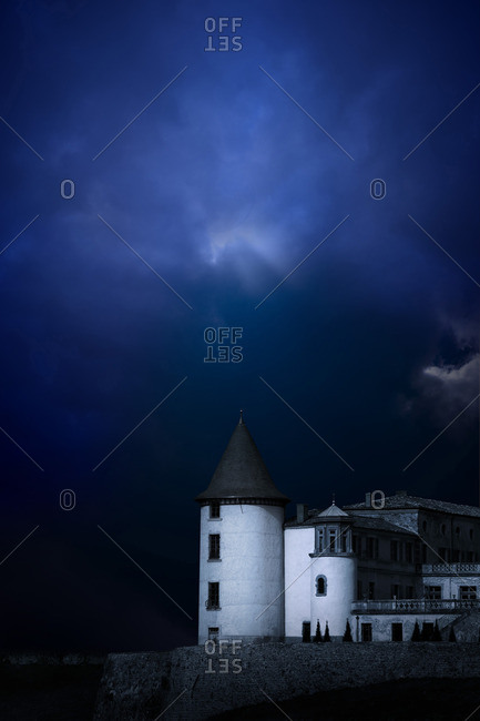 Chateau de Pramenoux with dramatic sky