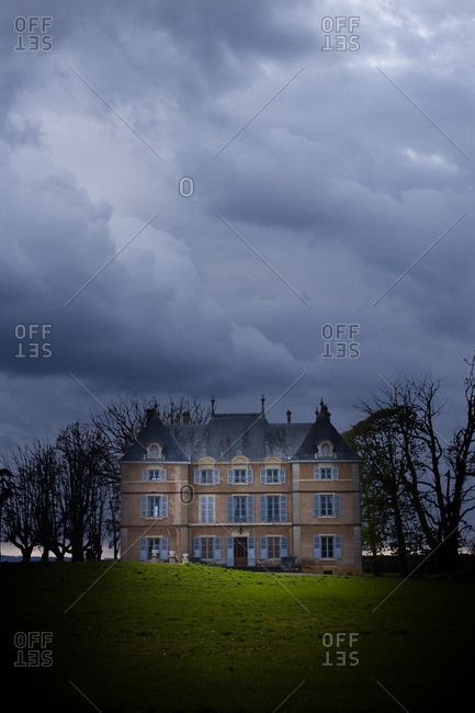 A chateau in Rhone-Alpes with dramatic sky