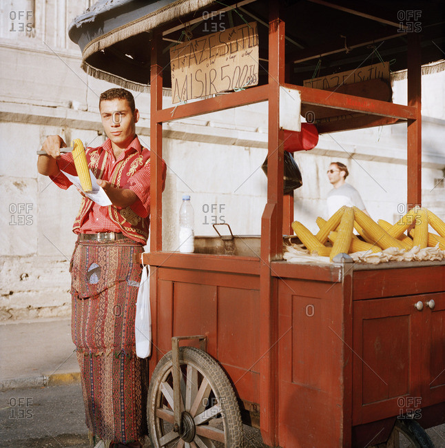October 12, 2015: A man with his push cart selling corn in Istanbul