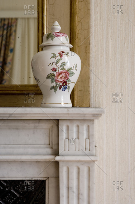 Detail of a vase on a fireplace