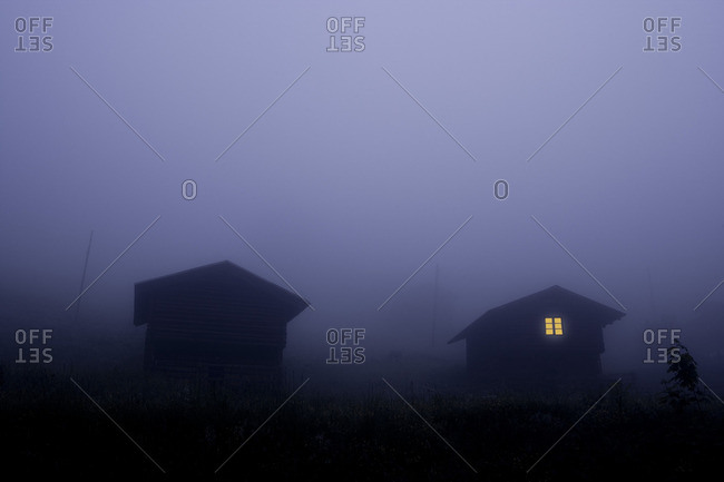Houses in Arosa in a misty night