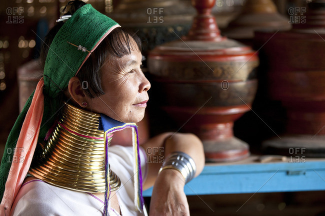 July 15, 2015: A woman with a golden brass spiral around the neck