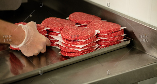 Close-up of raw hamburger patties in the butchers shop
