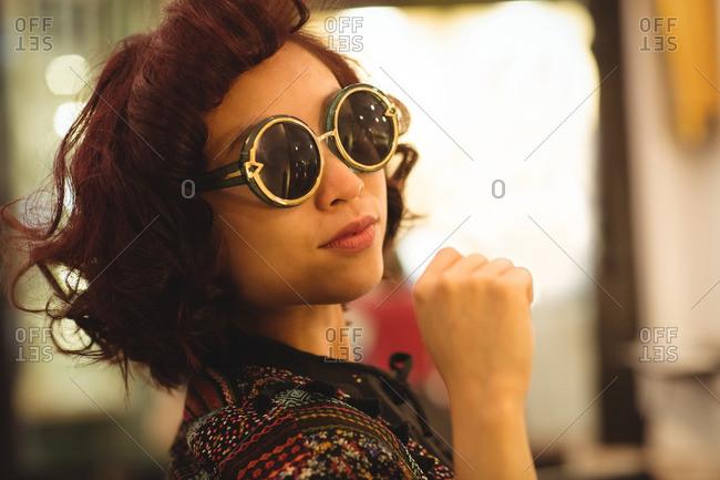 Portrait of stylish woman wearing sunglasses