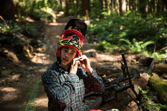 Male athletic wearing bicycle helmet in countryside
