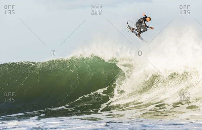 Jeffrey's Bay, South Africa - July 15, 2015: Talented surfer gets air while trying a trick