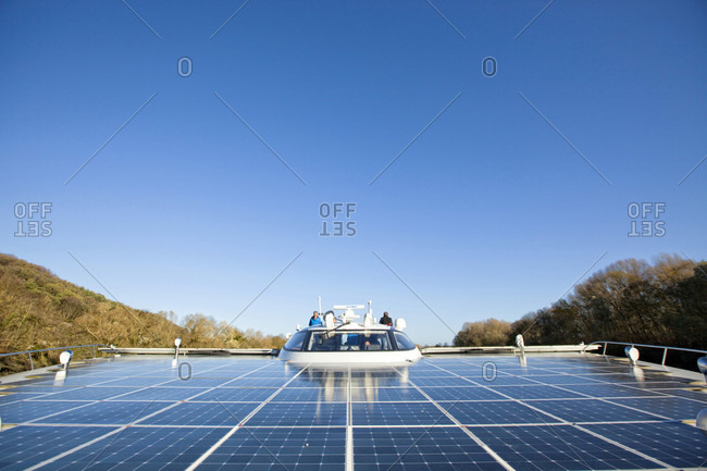Rouen, Seine-Maritime, France - November 18, 2015: Trip on the Seine river with the Planet Solar yacht  between Rouen and the D'Amfreville lock. The MS Turanor PlanetSolar is currently the largest solar boat ever built, Planet Solar was launched on March 31, 2010 after 3 years of feasibility studies, construction, tests, and optimizations. On May 4, 2012, after 585 days of navigation, the MS Turanor PlanetSolar reached Monaco, the starting point of the trip around the world, powered 100% by photovoltaic energy
