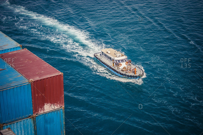 Suez, Egypt - April 8, 2014: Security forces approaching a container ship in the Suez Canal, waiting to board the ship and protect it's passage through the Red Sea and Gulf of Aden