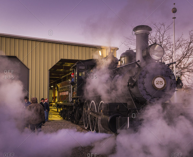 Carson City, Nevada, USA - December 17, 2011: Santa Train pulls out of engine house  at Nevada State Railroad Museum