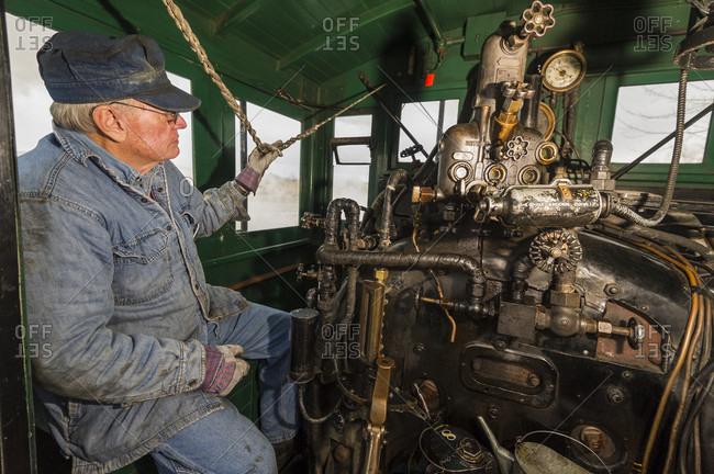 Carson City, Nevada, USA - December 15, 2012: Train engineer blowing whistle, Santa Train Nevada State Railroad Museum