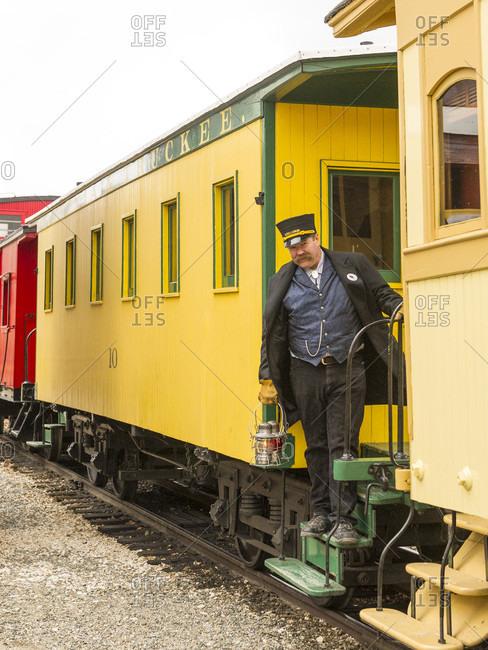 Carson City, Nevada, USA - December 15, 2012: Conductor makes sure all riders are aboard.   Santa Train Nevada State Railroad Museum