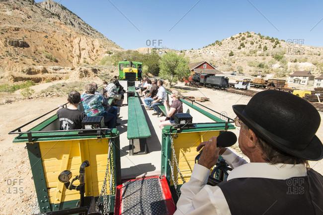 Virginia City, Nevada, USA - June 3, 2012: Riders look on as they enjoy a tour on the Virginia & Truckee Railroad, Virginia City Nevada