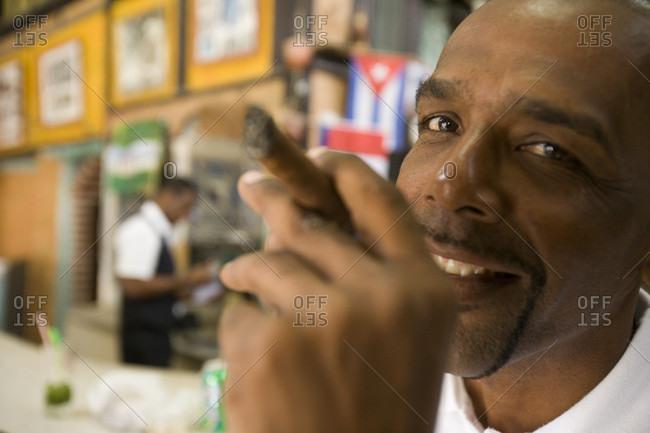 Havana, Cuba - March 22, 2009: Havana, Cuba - Cuban Man with his cigar in a close up, low depth of field portrait in a bar in old Havana