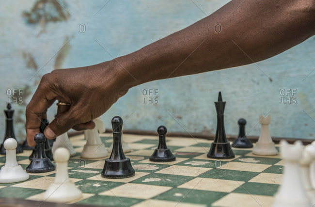 Havana, La Habana, Cuba - October 5, 2016: The arm of a Cuban man playing a game of street chess, close up. Street chess is very popular in Cuba. In fact, Cuba is ranked 17th in the world by the World Chess Federation. Havana Centro, La Habana, Cuba