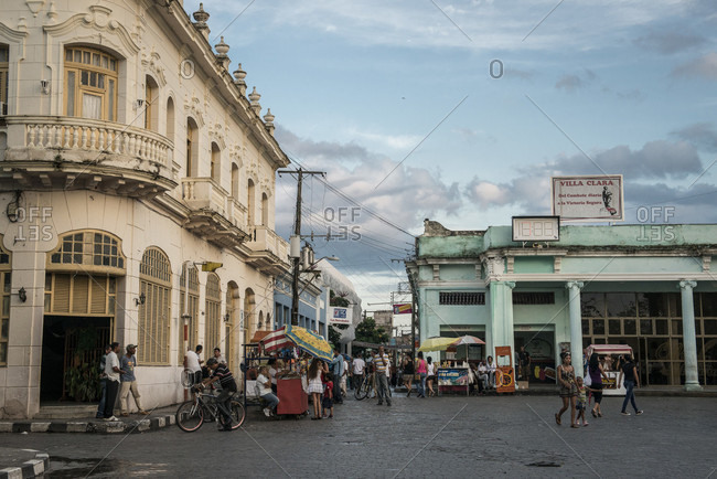 Santa Clara, Villa Clara, Cuba - May 3, 2014: Street vendors and pedestrians gather in the town square of Santa Clara, Villa Clara, Cuba just after a Spring rain