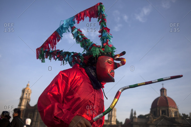 """Mexico City, Mexico - December 11, 2015: Dancers from El Palmar, Puebla, perform Saint James' dance during the annual pilgrimage to the Basilica of Our Lady of Guadalupe, Tepeyac Hill, Mexico City, Mexico. Guadalupe is known for indigenous as Tonantzin, that means """"Our Mother"""" in Mexican nahuatl language. Millions arrive every year to the pilgrimage"""
