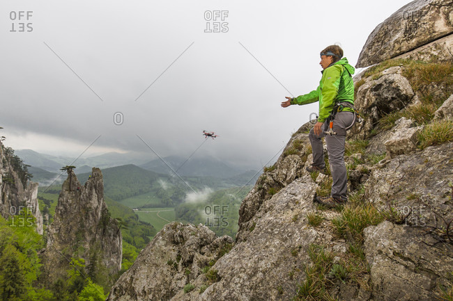 Peilstein, Austria - May 2, 2015: Highline Session in Austria. The connection between the anchors is build by a drone