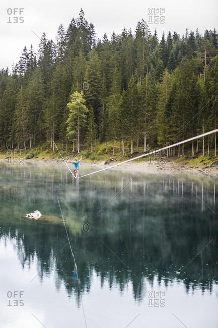 Lake Cauma, Switzerland - September 6, 2015: Slack liner on a waterline in Switzerland at lake Cauma