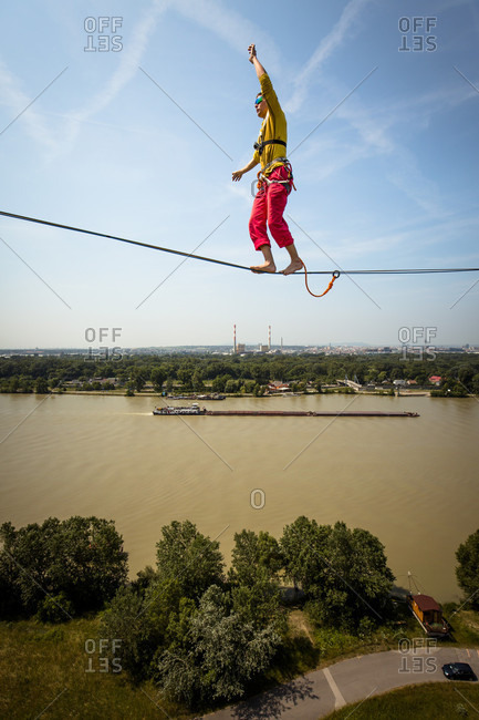 Vienna, Austria - June 11, 2015: Professional Athlete Peter Auer on the world's first wind turbine highline. This special project took place over the skyline of Vienna, Austria and involved some special equipment, rigging skills. The set up was about 50m long and about the same height