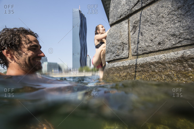 "Vienna, Austria - August 8, 2015: Impressions from the annual Urban boulder cup in Vienna. This event returned for the second time to the ""Reichsbrucke"" at the New Danube Channel. Athletes compete in a deep water solo climbing competition style against each other on preset routs. The height of the climbing wall is about 10 meters and any mistakes is automatically leading to a fall in the refreshing water"