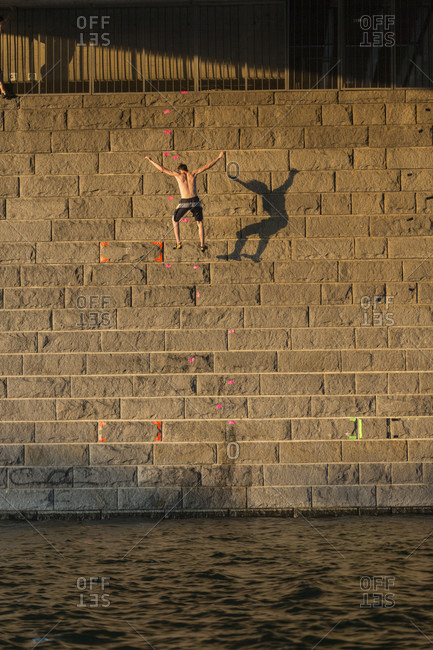 Vienna, Austria - August 8, 2015: Urban Bouldering and Deep Water Soloing in Vienna. In this special event called 'Urban Waters Cup' competitors climbing over the Danube in a special climbing event