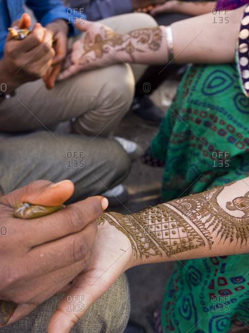 Jaipur, Rajasthan, India, Rajasthan, India - July 4, 2015: Henna being applied on woman's hand in Jaipur, Rajasthan, India