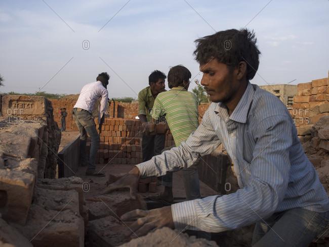 Chhatrasagar, Rajasthan, India - July 4, 2015: Workers working at construction site in Chhatrasagar, Rajasthan, India
