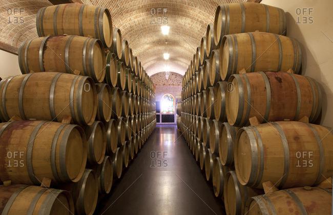 Ribera del Duero, Spain - September 21, 2015: Barrels in a wine cellar at Ribera del Duero in Spain