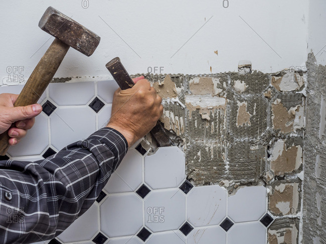 Tiles being removed from wall during a refurbishment