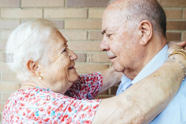Senior couple face to face