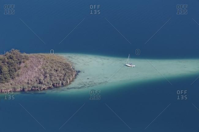 Austria- Carinthia- Lake Woerthersee- Small Island and sailing boat