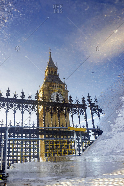 Great Britain- England- London- Big Ben mirrored in puddle