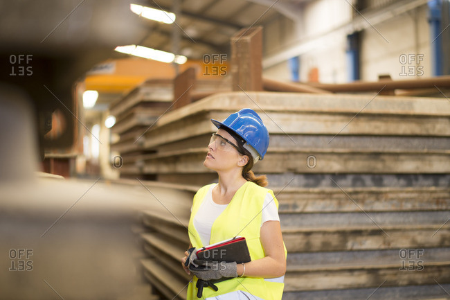 Woman with tablet in factory hall