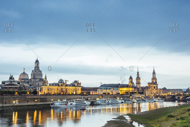Germany- Saxony- Dresden- historic old town with Elbe River in the foreground in the evening