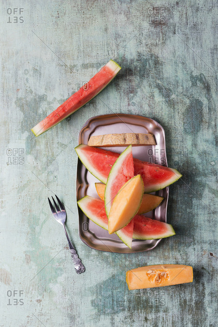 Plate with different fresh fruits