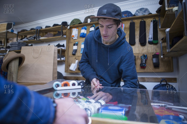 Salesperson in skater shop