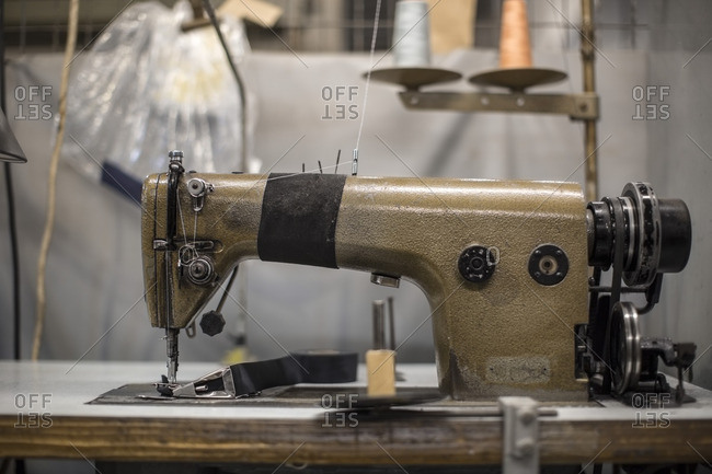 Sewing machine in tailor's workshop