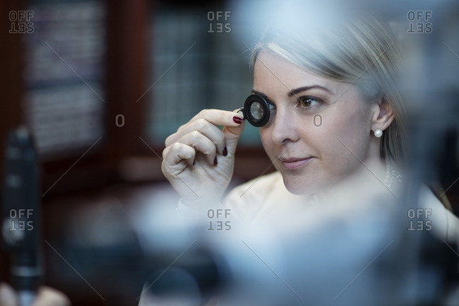Patient at optometrist trying different lenses