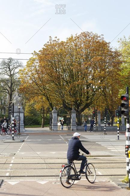 Amsterdam, Netherlands - October 14, 2016: Man on bike at park entrance