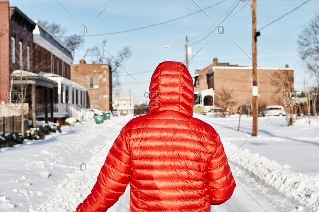 Person in street with deep snow