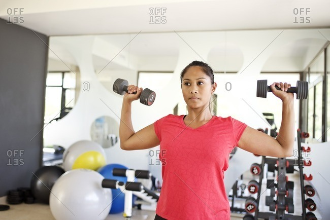 Woman doing arm workout with free-weight