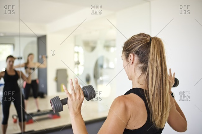 Woman doing workout with free weights