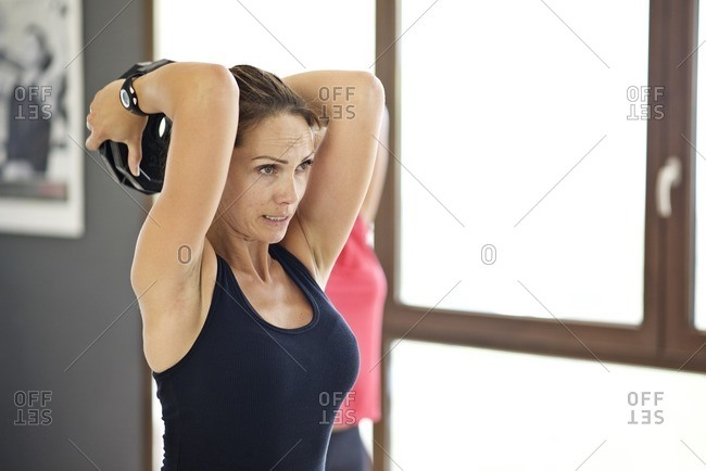 Woman doing triceps workout with weight