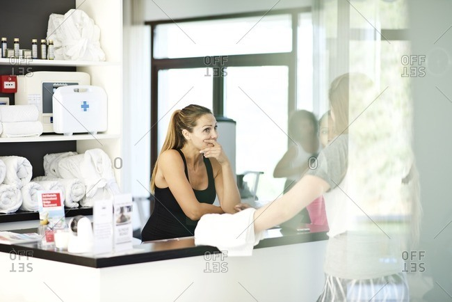 Women at desk of a gym