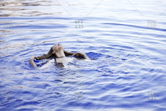 Woman floating alone in water