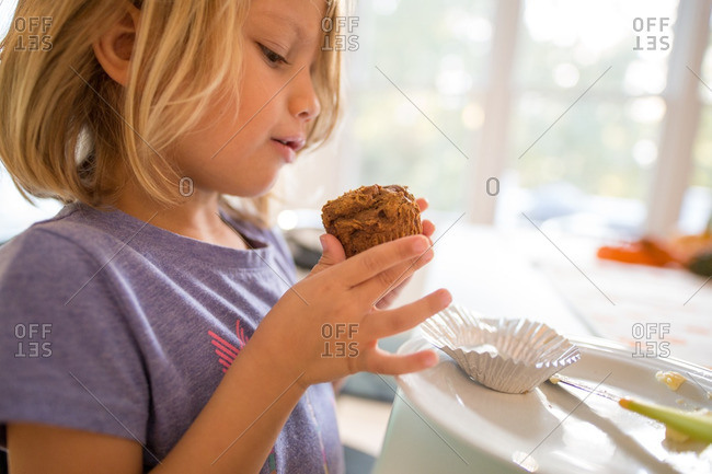 Girl about to enjoy a freshly baked muffin