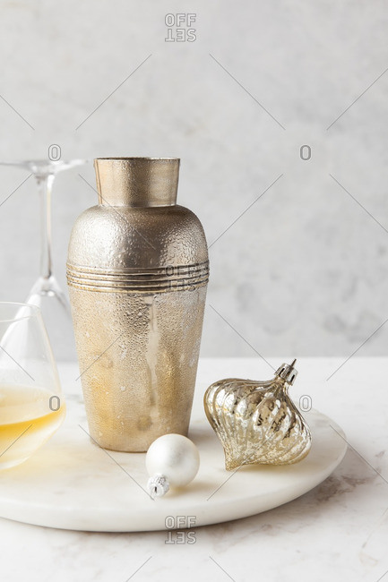 Cocktail next to shaker and ornaments