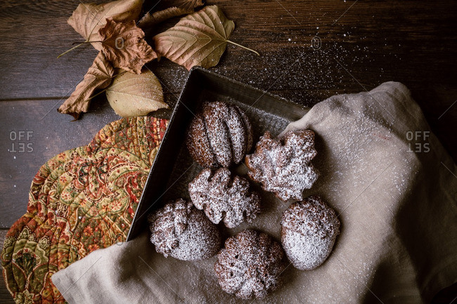 Molded cakes in autumn shapes dusted with powdered sugar