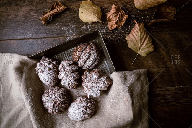Leaf, acorn and pumpkin-shaped chocolate cakes in pan